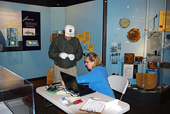 Two staff members cataloging objects in the visitor center at Fort Meigs.