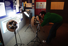 Assistant registrar taking photographs of items on display in the visitor center at Fort Meigs.