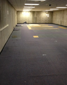 Before view of the old carpet in the Microfilm Room.