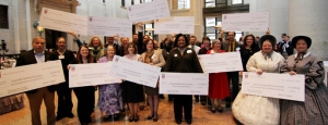 "Recipients of Ohio History Fund grants posing with their ""big checks"" at the Ohio Statehouse."