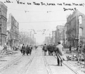 Photographic postcard depicting flood damage on Third St. in Dayton, Ohio.
