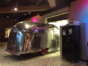 Airstream camper being pulled onto the museum floor of the Ohio History Center in preparation for the opening of 1950s: Building the American Dream.