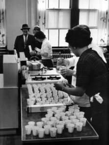 Volunteers working in a school kitchen in Youngstown, Ohio, diluting polio vaccines with distilled water in preparation for distribution; courtesy of the Rose Melnick Medical Museum, Youngstown State University; accessible online via the Ohio Memory Project.