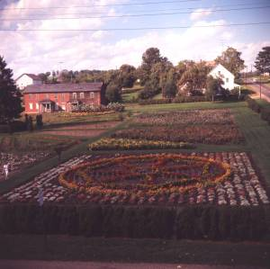Photograph of the garden in  Zoar, Ohio taken in the 1960s after the garden and garden house were restored. Many of the German-style structures built by the Zoarites have been restored and are open to the public as Zoar Village State Memorial, operated by the Ohio Historical Society and the Zoar Community Association.