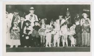 Photograph of children in a variety of Halloween costumes in the 1940s, including a Mickey Mouse. Photograph is from the Ohio Guide Collection, State Archives Series 1039 AV.