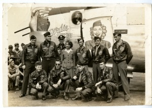 "Birdie and the Crew at the christening of the ""Birdie Schmidt ARC"" August 1944. Back row left to right: Lt. Wise, Lt. Hoffman, Lt. Randall, Birdie, Lt. Gorton, Cpl. McNutt, S/Sgt. Goo. Front row left to right: T/Sgt. Boney, S/Sgt. Sanders, S/Sgt. Kamacho, S/Sgt. Dopson."