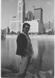 Danny Spears, 1987 Mr. Gay Columbus, posing downtown by river.