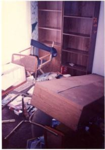 Anti-gay vandalism, in unidentified home in Columbus, Ohio. Shelf contents swept to floor, bookcase pulled off wall.