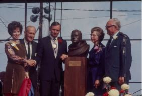"Neil and his parents Stephen and Viola (at right) attend dedication of moon landing bust. Bust reads ""Neil A. Armstrong, First Man on the Moon, Apollo XI"". More than 80,000 supporters greeted Neil Armstrong upon his return to Wapakoneta, Ohio on September 6, 1969. Bob Hope served as marshal for the event, and guests included ""Tonight Show"" sidekick Ed McMahon, Governor James Rhodes, Mayor Donald Wittwer, and Dr. Albert Sabin, inventor of the polio vaccine."