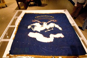 The flag completely unfurled.  The eagle pattern missing in the center of the flag was the Arms of the United States.