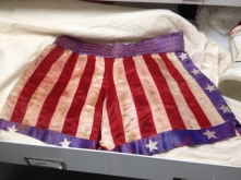 How do you preserve iconic American objects? Here, the boxers featured in the Rocky movies are carefully kept in an archival cabinet in a temperature controlled facility.