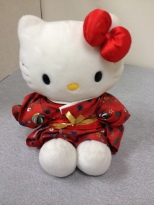 A Hello Kitty plush doll purchased by curator Emily Lang at King's Island in Mason, Ohio in 2002.
