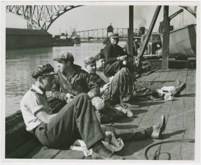 Dockworkers eating lunch ...