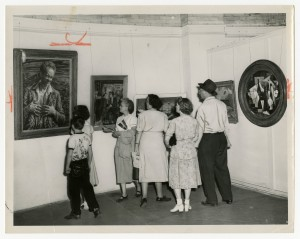 A crowd gathers around a self portrait of Burkhart on exhibit at the Ohio State Fair, from the Ohio History Connection collections, SC 22.