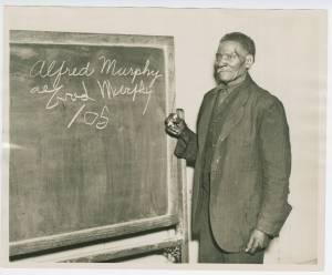 Former slave Alfred Murphy in WPA literacy class.
