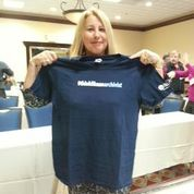 Deborah Clark Dushane with one of her prizes, a t-shirt that says #thinklikean archivist.