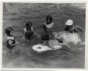 "Four children participating in the WPA ""Learn to swim"" campaign at the pool in Navarre, Ohio.   These ""Learn to Swim"" campaigns were part of the Works Progress Administration, a project that hired unemployed Americans to work on various government projects from April 8, 1935 to June 30, 1943."