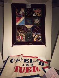 One section of the textile installation that features a quilt raffled of by the GAR and a political banner from the 1888 presidential election.