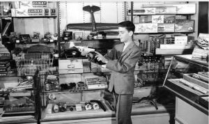 Lazarus Family Collection, photograph of Nadine Burden's son admiring a toy plane in The F. & R. Lazarus Company's toy department, ca. 1950-1959.
