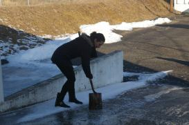 Manuscripts Processing Assistant Adria Seccareccia chisels ice from the warehouse ramp.