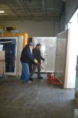 Manuscripts Curator Matt Benz and Assistant Curator of Archaeology Bill Pickard use a pallet jack to move a cabinet.