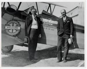 Walt Anderson and Billy Ingram with their airplane.