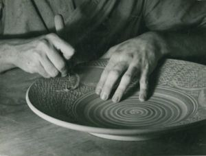 From State Archive Series 1039, Ohio has a long history in the ceramic industry. In this WPA photo from the 1930s, a potter cuts a design into clay.