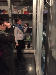 Natural History Curator Erin Cashion and History Curator Becky Odom explore the Luce Center display at the Brooklyn Museum with flashlights to protect the objects from constant exposure to light.