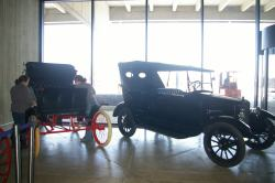 The Winton and Seneca automobiles look great in their new place on the plaza level!